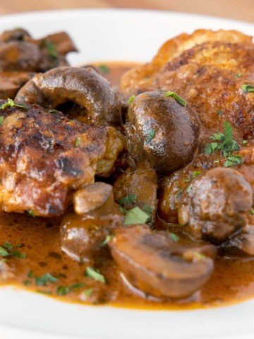chicken chasseur on a white plate