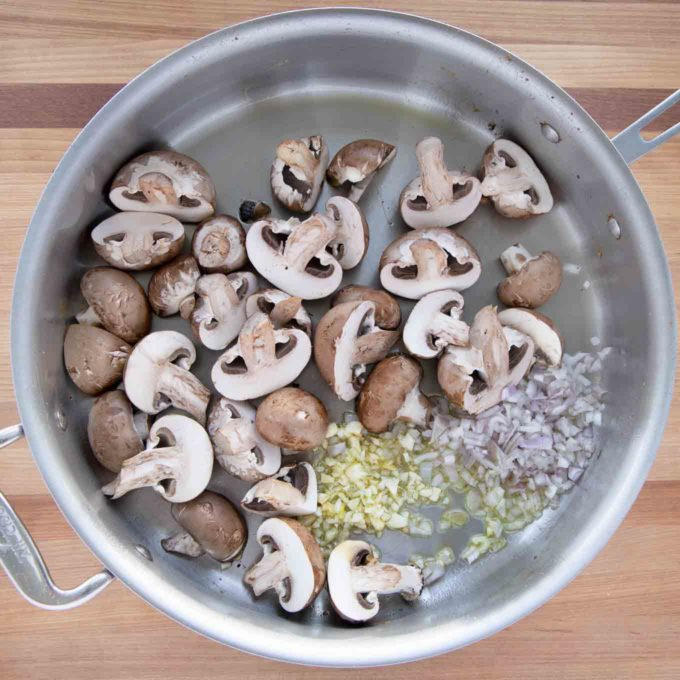 mushrooms, shallots and garlic with olive oil in the skillet