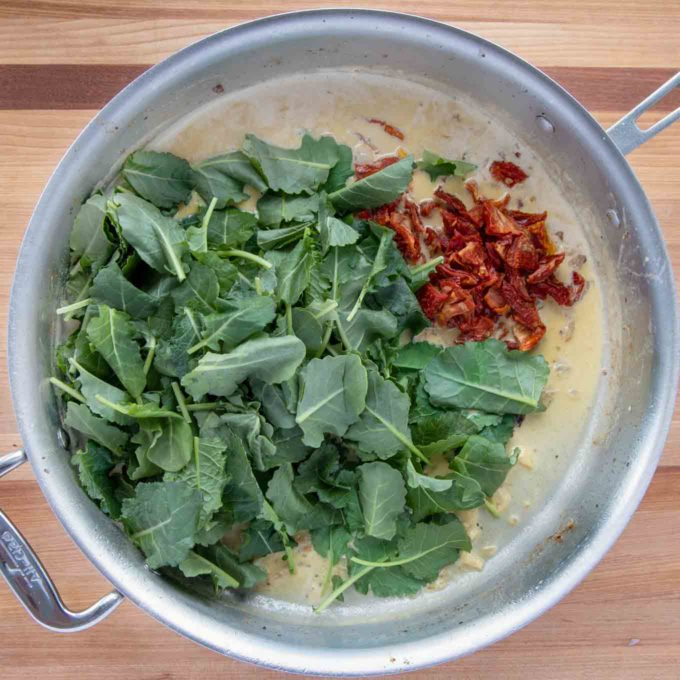 spinach and sun dried tomatoes added to the skillet
