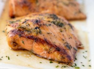 crispy browned Irish whiskey salmon on a white platter