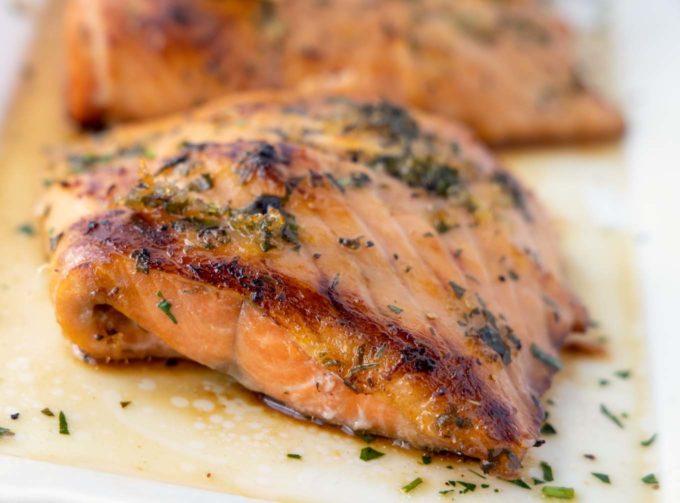 crispy browned Irish whiskey salmon on a white platter