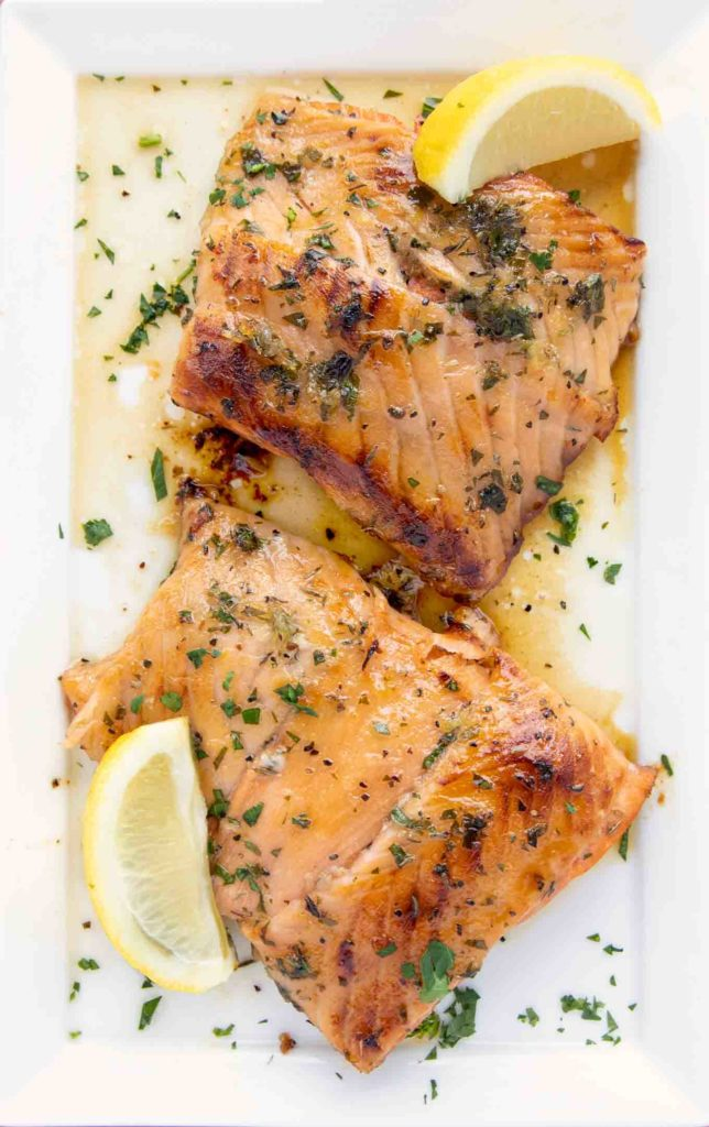 two portions of Irish Whiskey Salmon on a white platter