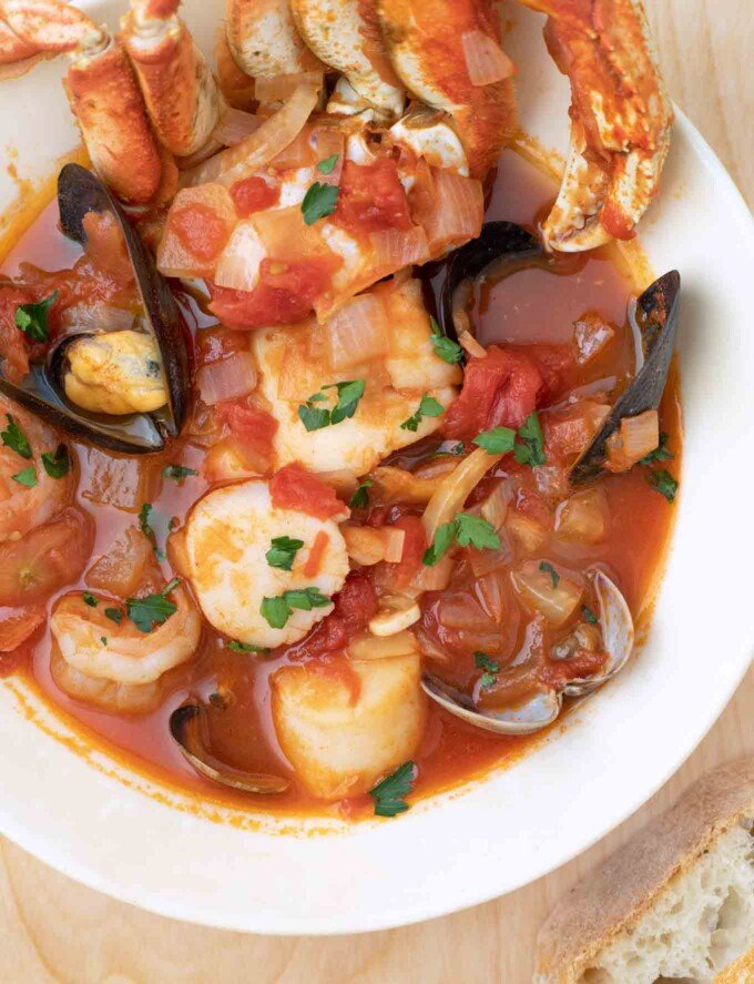 overhead shot of cioppino in a white bowl