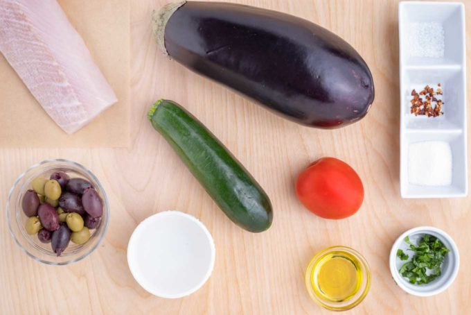 overhead view of ingredients to make grilled mahi-mahi with caponata on a cutting board