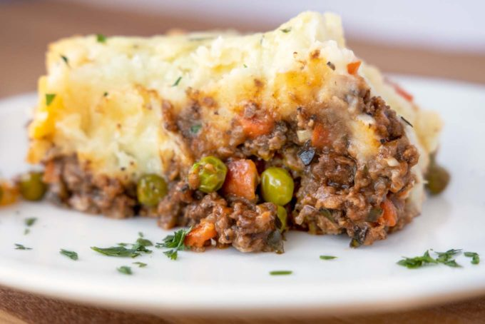 side view of slice of shepherd's pie on a white plate