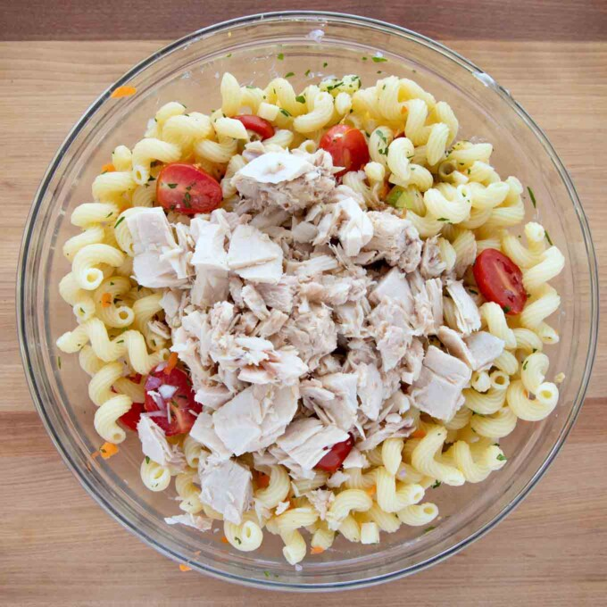 tuna added to the bowl of pasta salad