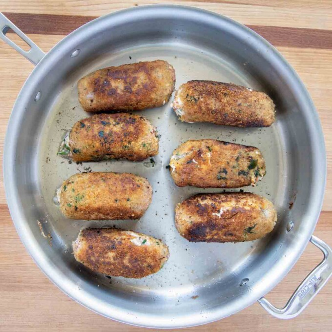 browned braciole in saute pan