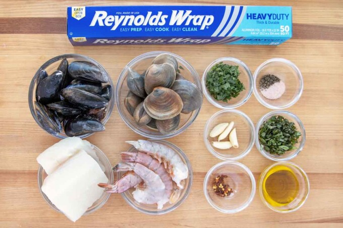 ingredients to make a seafood combo foil packet