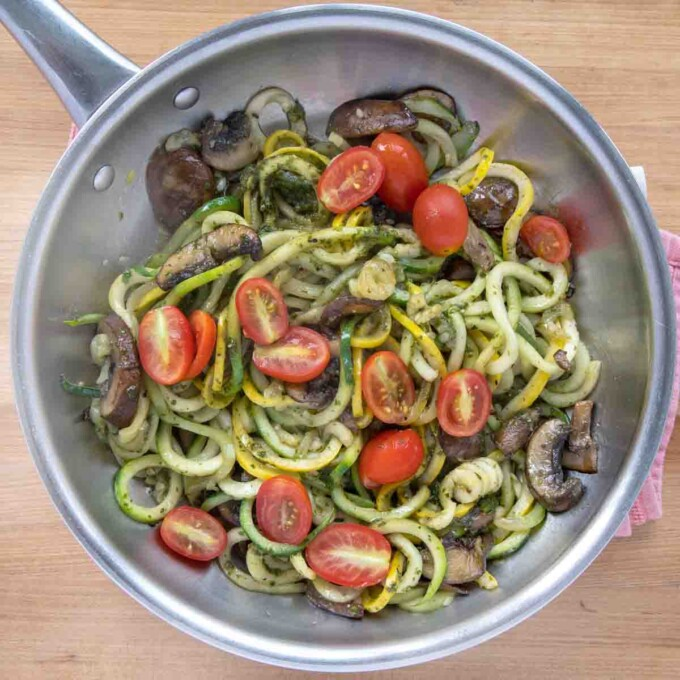 tomatoes added to zucchini noodles and tomatoes