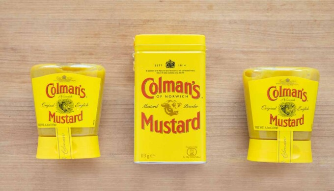 image of two jars of Colman's prepared mustard with a can of Colman's dry mustard in the middle