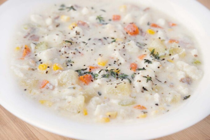 close up of fish chowder in white bowl