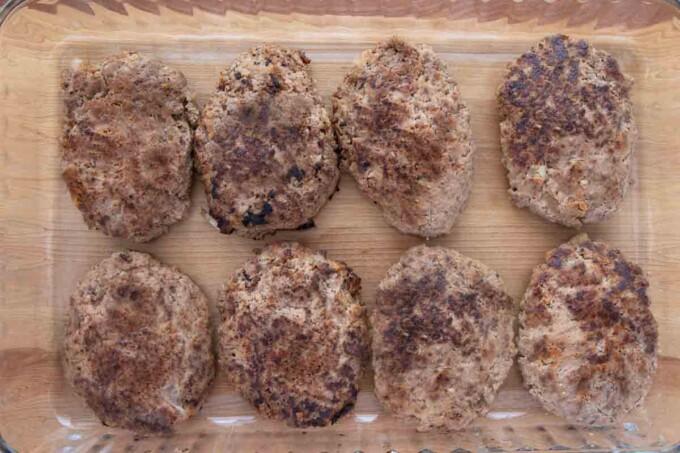 browned salisbury steaks in baking dish